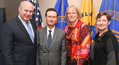 Left to Right: Michael Saag, M.D., HRSA Administrator Dr. George Sigounas, HAB Associate Administrator Laura Cheever, and HAB Deputy Heather Hauck