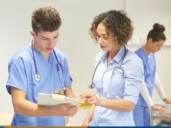 photo of two health professionals looking at a patient's chart