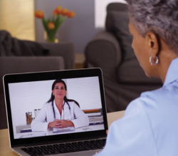 photo of a woman in a telehealth appointment