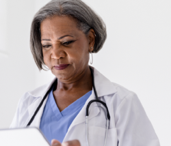 photo of a doctor looking at a patient's chart