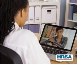 photo of a woman on a telehealth call with a doctor
