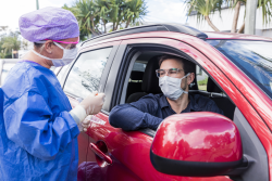 photo of a person in a car getting tested for COVID-19
