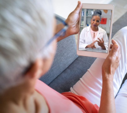 photo of a woman on a telehealth call
