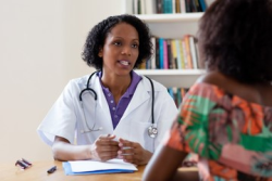photo of a woman talking with her doctor