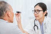 photo of a man being examined by a doctor