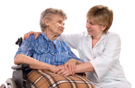 A senior sits with a nurse