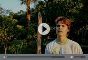 A video still of a young farmer