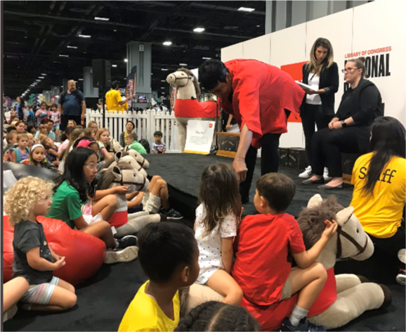 Children listening to a story at a past National Book Festival