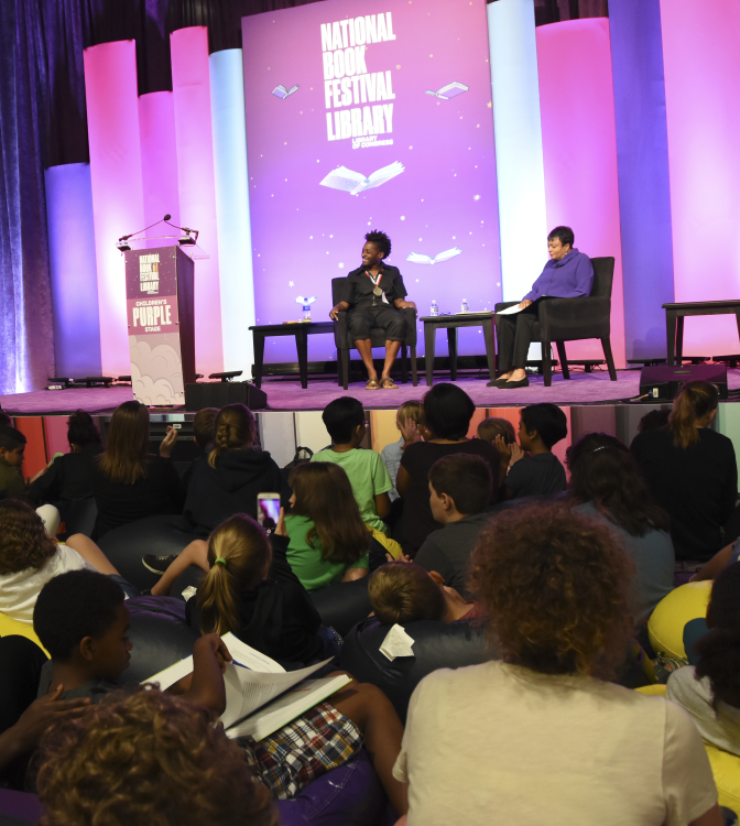 Dr. Carla Hayden on stage with guest at 2019 National Book Festival