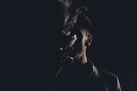 Photo of young male smoking marijuana, associated with January 2019 research spotlight article on more young people using marijuana before cigarettes and alcohol.