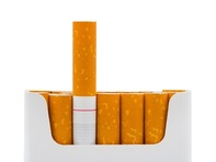 Photo of pack of cigarettes with one sticking out, associated with April 2019 research spotlight article called 'Can genetics determine your cigarette preference? African Americans and menthol cigarette use.