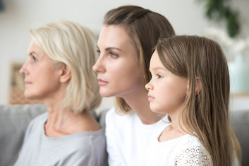 Portrait of grandmother, mother, and daughter