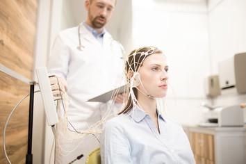 Woman undergoing electroencephalography