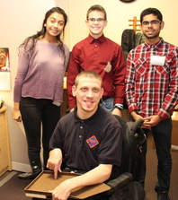 NIH staff member Ricky Day with local high school students