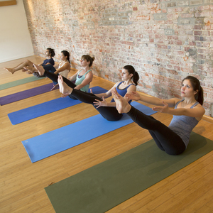 yoga practitioners in row