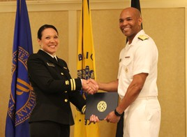 LT Adelaida Rosario receiving her USPHS graduation certificate from U.S. Surgeon General Jerome Adams