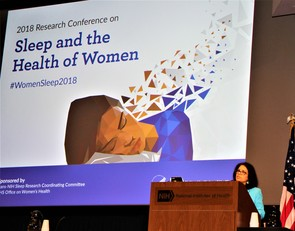 Dr. Rina Das presenting at the podium at the 2018 Women's Sleep Conference