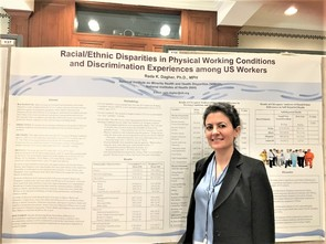 Dr. Rada Dagher standing in front of poster
