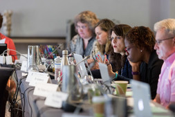 Group of scientists discussing at table