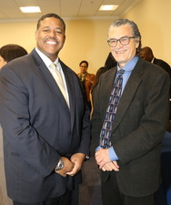 Dr. Perez-Stable shaking hands at the Congressional Briefing
