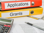 Binders with labels: applications and grants
