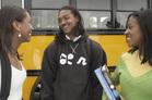 Stock Photo-Girls Standing Near School Bus