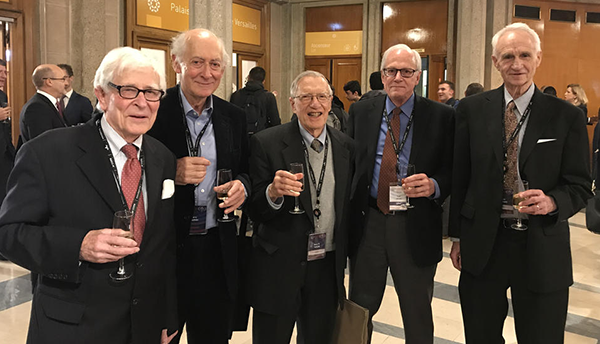 Five scientists celebrating at SI redefinition vote.
