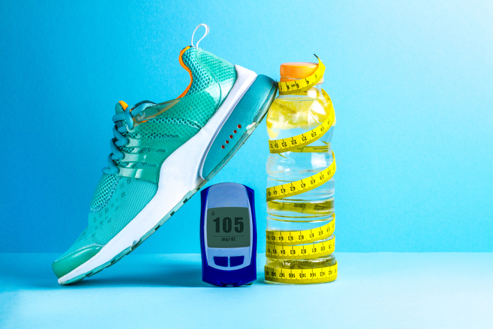 borderline diabetes, green running shoe, glucose monitor, water bottle, tape measure
