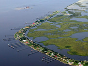 Aerial view of homes and wetlands along the Louisiana coast.