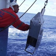 A commercial vessel crew member recovers a continuous plankton recorder. NOAA Fisheries