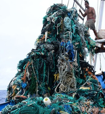 Massive net entanglement being pulled aboard a boat.