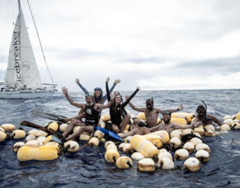 A crew investigates a massive raft of foam floats in the ocean.