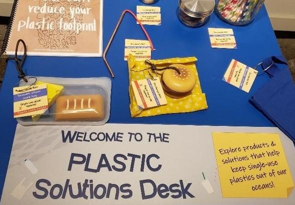An interactive marine plastics exhibit containing plastic solutions.
