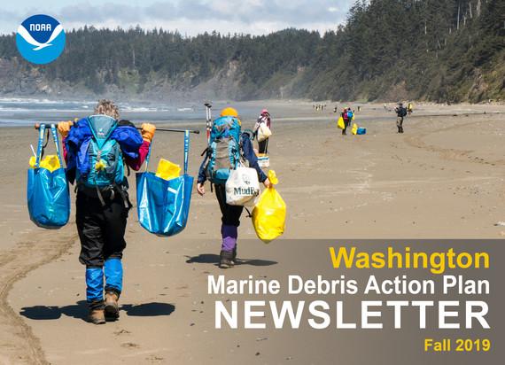 Two volunteers at a Washington coastal beach clean up.