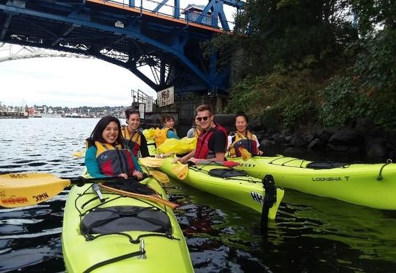Volunteers in kayaks on Lake Union.