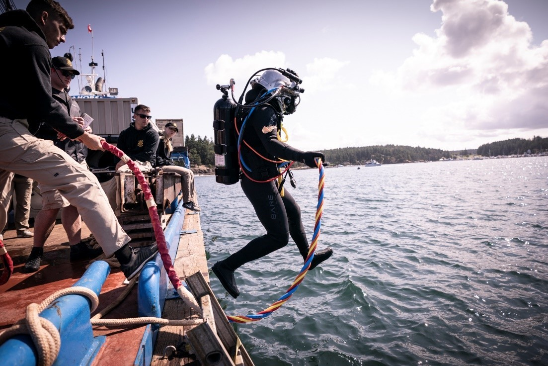 Army diver jumping into the waters off of San Juan Island, Washington.