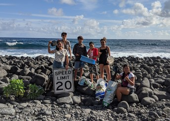 Students at a beach cleanup.