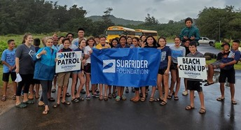 Middle school students participate in a beach cleanup.