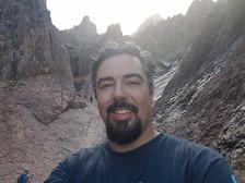 The new NOAA Marine Debris Program's Pacific Northwest Regional Coordinator pictured hiking.