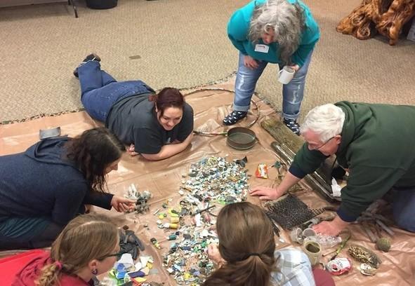 Workshop participants sort collected marine debris.