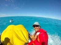 NOAA team member riding on boat.