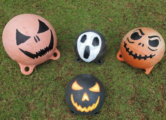 Recovered buoys painted like jack-o-lanterns.
