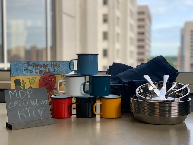 A zero waste kit that includes reusable cups, plates, silverware, and napkins.
