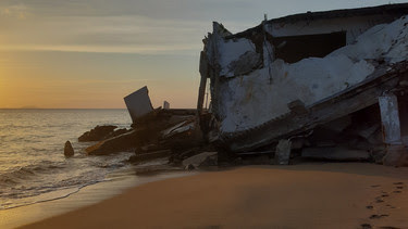 house down on coast ruined