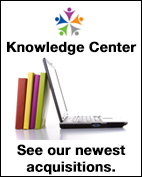 OMHRC logo. Knowledge Center. Laptop propped up by books. See our latest acquistions.