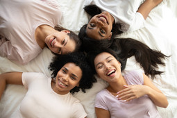 Diverse women in a circle laughing