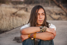 Image shows a young Native American man
