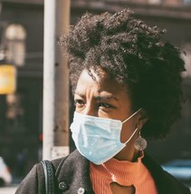 Image shows a Black/African American woman wearing a facemask
