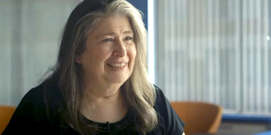 Radia Perlman sitting and smiling during an interview