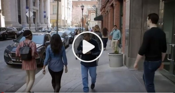 Screenshot of Suicide Lies video. Man walking in the street.